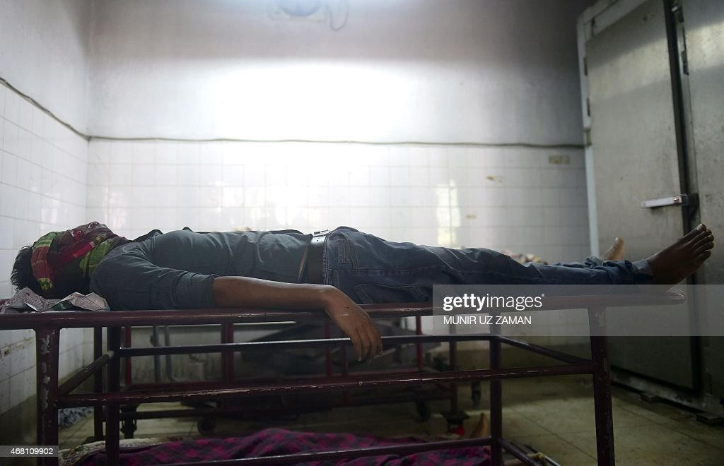The body of Bangladeshi blogger Washiqur Rahman lies in a morgue at Dhaka Medical College in Dhaka on March 30 after he was killed in an attack in...