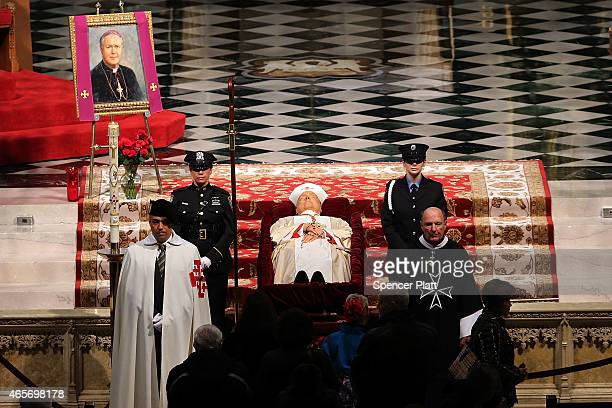 The body of Cardinal Edward M Egan is viewed lying in state during a public viewing at St Patrick's Cathedral on March 9 2015 in New York City New...
