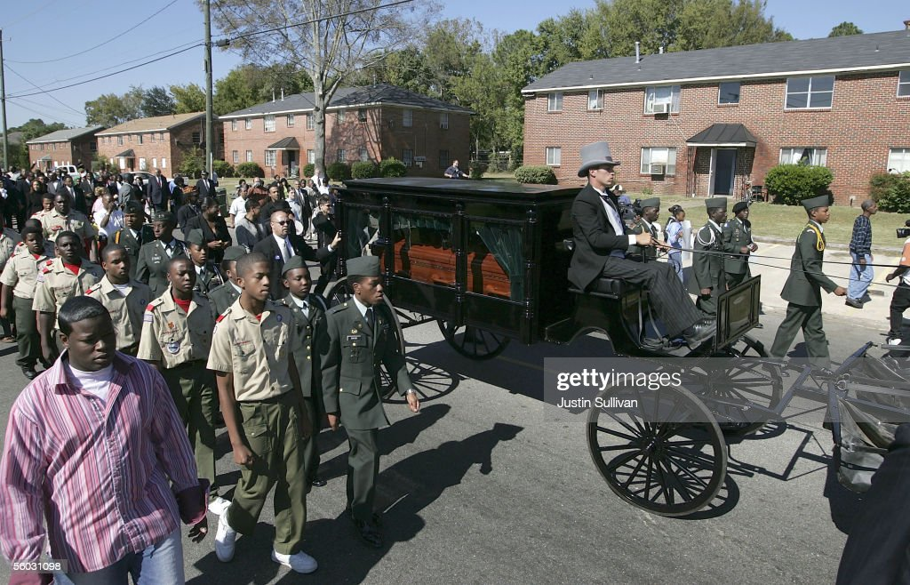 The body of civil rights pioneer Rosa Parks is transported to the St Paul AME Church in a horse drawn carriage for public viewing October 29 2005 in...