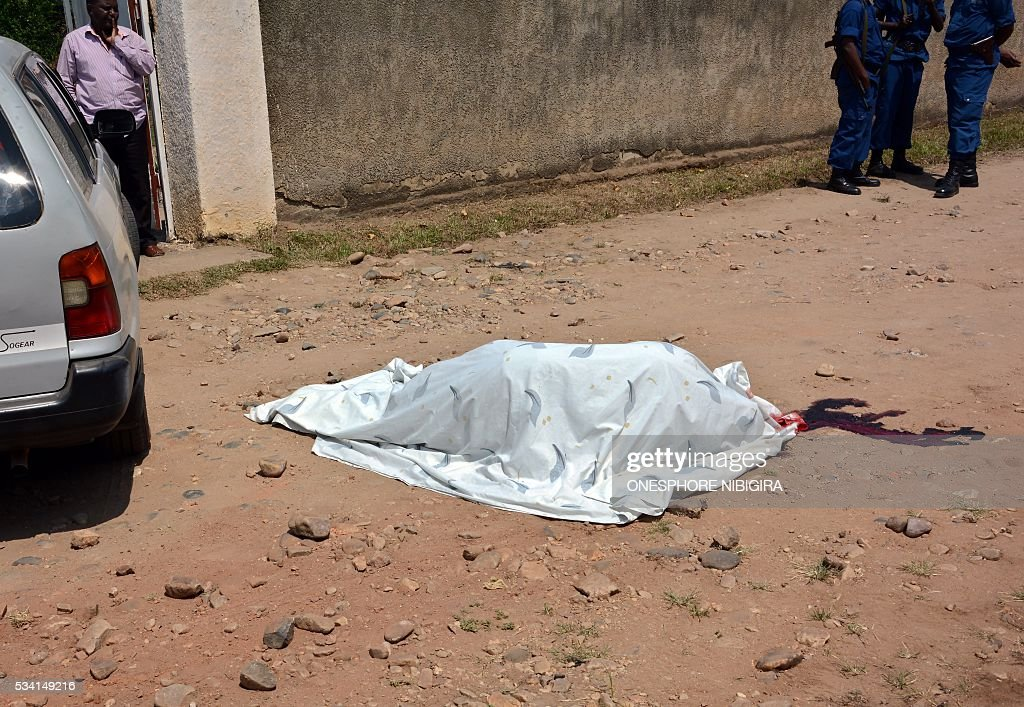 The body of Col. (Rtd) Lucien Rufyiri lies on the street May 25, 2015 in the Burundian capital, Bujumbura after he was gunned down by unidentified gunmen as he arrived at his residence. The Tutsi colonel who has been retired for several years was killed outside his home in a rebellious district of Bujumbura 'by armed criminals', according to a source within the family. 'Colonel Lucien Rufyiri has been murdered this morning in front of his house and a son who was with him was injured,' he told AFP a family member, who requested anonymity. / AFP / ONESPHORE
