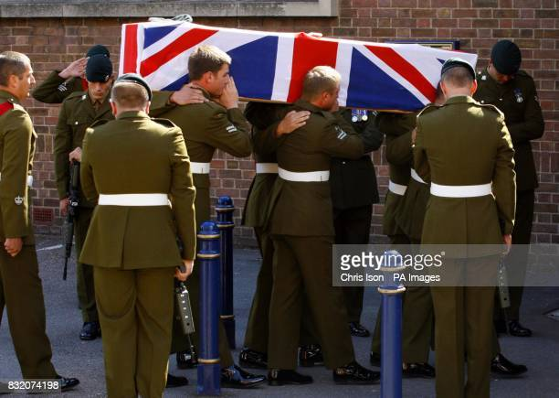 The body of Cpl John Johnston Cosby is carried into Belmont Chapel in Exeter for his funeral by colleagues from his regiment