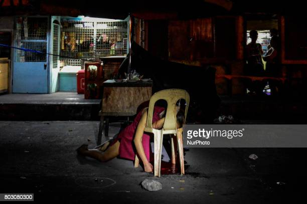 The body of Cristita Padual is slumped on a chair after she was shot dead by unknown assailants in Quezon city north of Manila Philippines March 4...