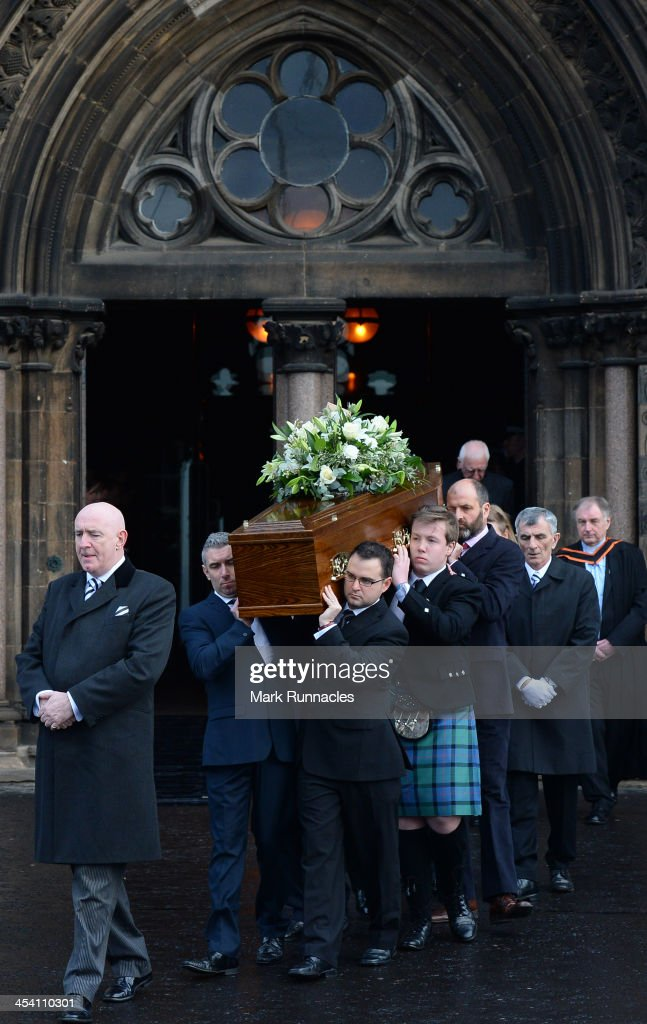 The body of David Traill is carried from the funeral service at the University of Glasgow's Bute Hall for Helicopter Pilot David Traill who died when...