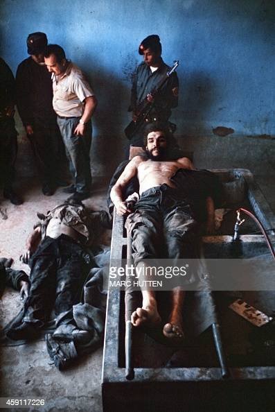 The body of Ernesto 'Che' Guevara the Argentineborn hero of Latin American revolutionaries and six other guerillas are on public display 10 October...
