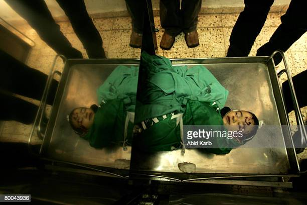 The body of fivemonth old Mohammad Naser AlBuri lies in the morgue at the Alshifa hospital before during his funeral February 28 2008 in Gaza City...