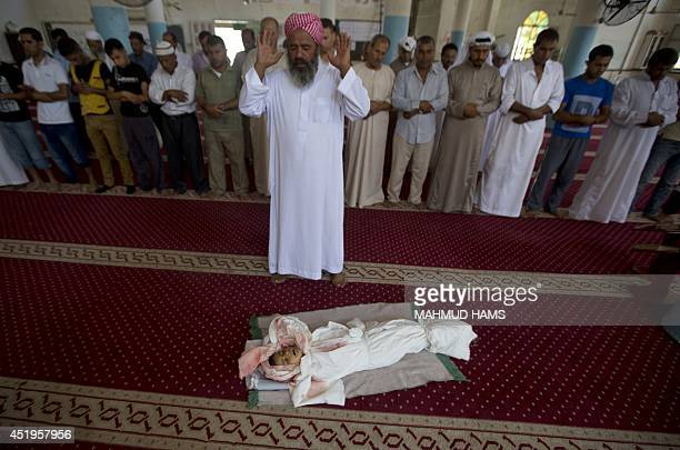The body of fiveyearold Palestinian boy Abdallah Abu Ghazal lies at a mosque during a funeral ceremony in the northern Gaza town of Beit Lahiya on...
