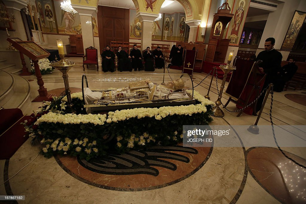 The body of Greek Orthodox patriarch of Syria, Ignatius IV Hazim is diplayed at the Saint Nicolas Church in the Lebanese capital Beirut on December 7, 2012. Patriarch Hazim, died on December 5, in neighbouring Lebanon at the age of 92 after a stroke.