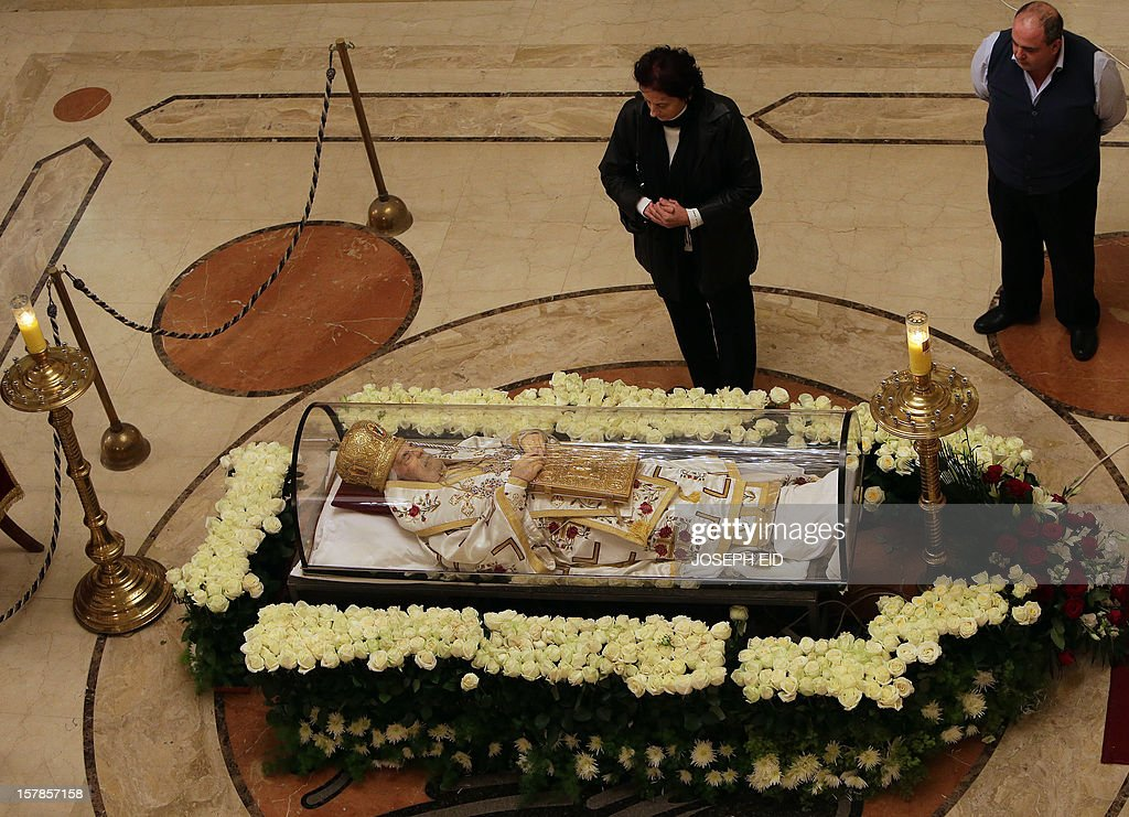 The body of Greek Orthodox patriarch of Syria, Ignatius IV Hazim is diplayed at the Saint Nicolas Church in the Lebanese capital Beirut on December 7, 2012. Patriarch Hazim, died on December 5, in neighbouring Lebanon at the age of 92 after a stroke. AFP PHOTO /JOSEPH EID