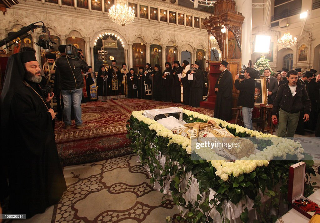 The body of Greek Orthodox Patriarch of Syria Ignatius IV Hazim, is layed out at the Mariamite Cathedral of Damascus, on December 9, 2012. Patriarch Hazim died in neighboring Beirut, Lebanon, of a stroke on December 5, and his body has been taken to Syria for burial on December 10. AFP PHOTO/STR