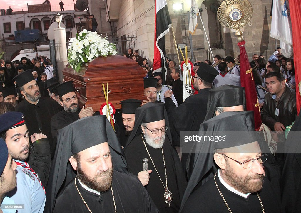 The body of Greek Orthodox Patriarch of Syria Ignatius IV Hazim, is carried into the Mariamite Cathedral of Damascus, on December 9, 2012. Patriarch Hazim died in neighboring Beirut, Lebanon, of a stroke on December 5, and his body has been taken to Syria for burial on December 10.