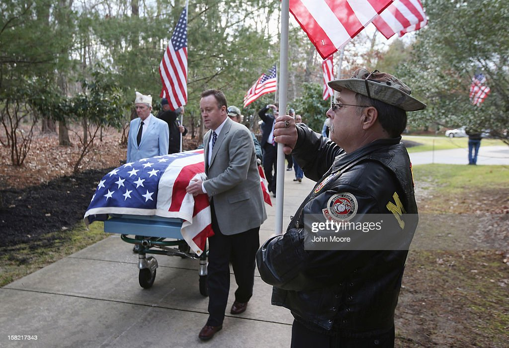 The body of Hurricane Sandy victim David Maxwell arrives for burial at the Calverton National Cemetery on December 11, 2012 near the Wading River hamlet of Long Island, New York. Maxwell, 66, was the last of Sandy's victims found on the Staten Island borough of New York City, when his body was discovered in his Midland Beach home 11 days after the storm. A Vietnam veteran, he was buried at the national cemetery, accompanied by honor guards from the Catholic War Veterans and the Patriot Guard Riders.
