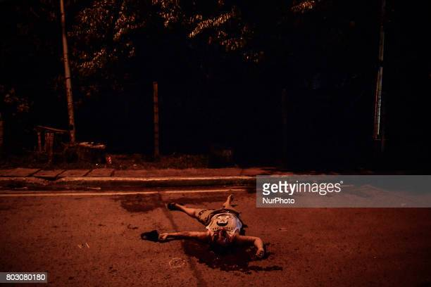 The body of Irish Glorioso lies in a pool of blood after he was shot dead by unknown assailants in Navotas north of Manila Philippines June 8 2017...