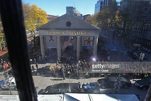 The body of late Boston mayor Thomas Menino leaves Faneuil Hall draped in the Boston city flag