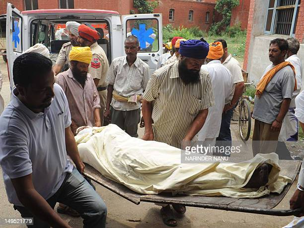 The body of Manpreet Kaur who was killed when the school bus she was travelling in collided with a railbus train in Kotmehatab is brought to a morgue...