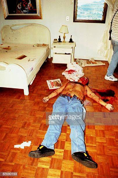 The body of Mario Castano Molina lies on the floor of a downtown Medellin hotel room in Colombia 19 March 1993 after a special police unit tracked...