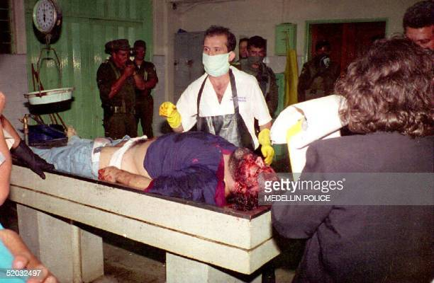 The body of Medellin drug cartel leader Pablo Escobar is examined by coroners at the Medellin morgue in Colombia late 02 December 1994 hours after...