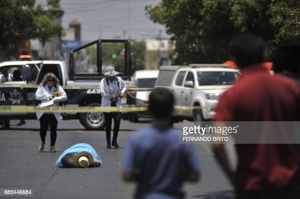 TOPSHOT The body of Mexican journalist Javier Valdez lies on the street after he was shot dead in Culiacan Sinaloa Mexico on May 15 2017 Valdez who...