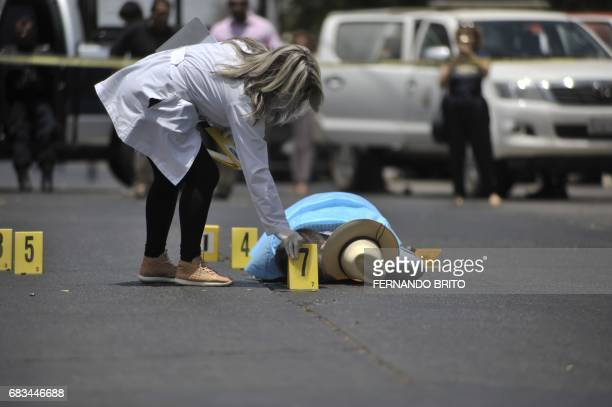 The body of Mexican journalist Javier Valdez lies on the street after he was shot dead in Culiacan Sinaloa Mexico on May 15 2017 Valdez who worked...