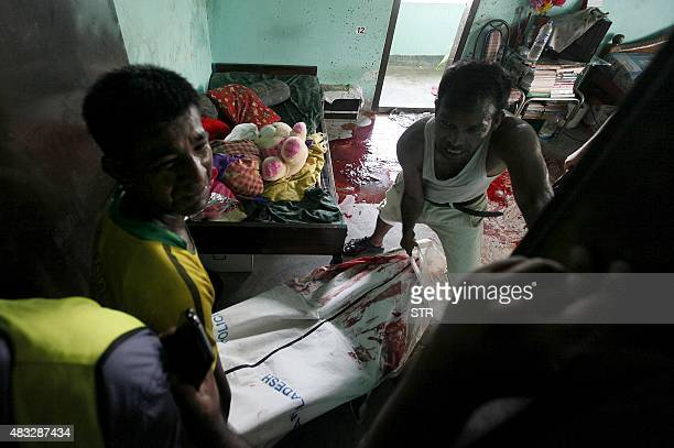 The body of murdered Bangladeshi blogger Niloy Chakrabarti who used the penname Niloy Neel is moved from his home in Dhaka on August 7 2015 A gang...