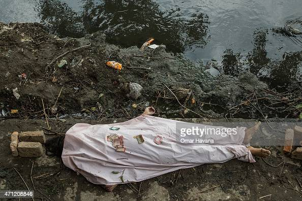 The body of one of the victims of the earthquake that hit Nepal yesterday lays on the floor ready for cremation on April 26 2015 in Bhaktapur Nepal A...