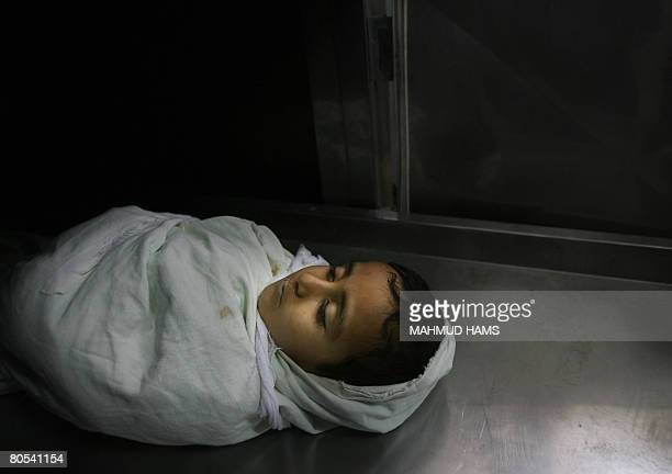 The body of Palestinian boy Abdullah Bhar lies at the morgue of alAqsa hospital in the Bureij refugee camp on April 6 2008 A Palestinian boy was shot...