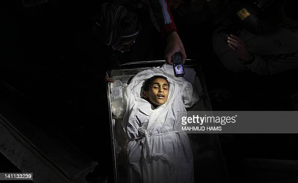 The body of Palestinian boy Ayoub Asalya 12yearold lies in the morgue of Kamal Edwan hospital in Beit Lahia in the northern Gaza Strip on March 11...