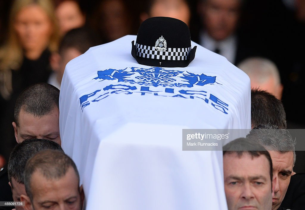 The body of PC Kirsty Nelis is carried from the funeral service at St Andrews Cathedral PC Kirsty was killed in the Clutha Bar Helicopter Crash on...