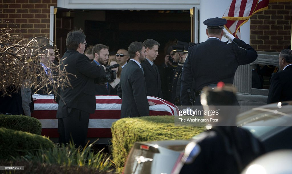 The body of Prince William County Police Officer Chris Yung, 35-years-old is carried from Hylton Memorial Chapel in Woodbridge, VA on Friday, January 4, 2013.