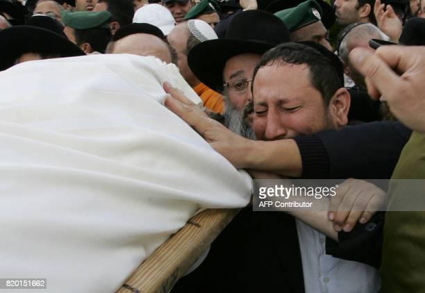 The body of Rabbi Yitzhak Kaduri is taken for burial at the Givat Shaul cemetery in Jerusalem 29 January 2006 Mystical Jewish rabbi Yitzhak Kaduri...