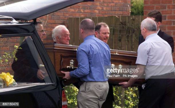 The body of Rosemary Nelson is carried by family back into her home in Lurgan County Armagh Nelson died in hospital yesterday from horrific injuries...