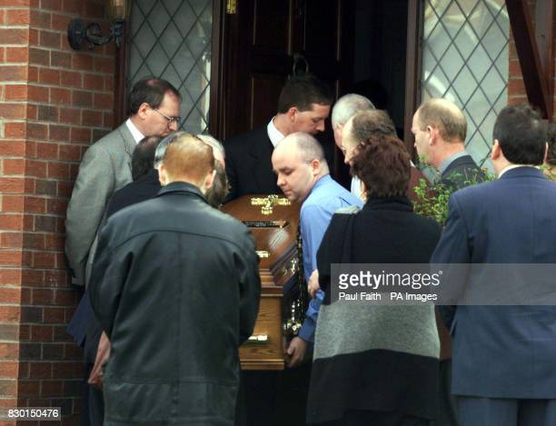 The body of Rosemary Nelson is carried by family back into her home in Lurgan County Armagh Nelson died in hospital from horrific injuries two hours...