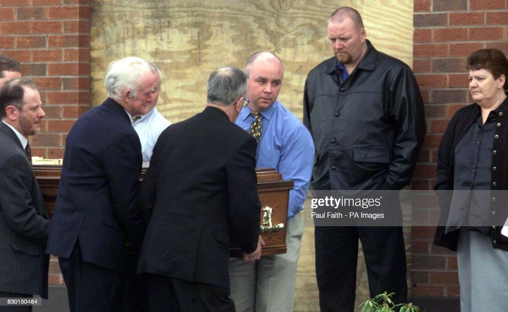 The body of Rosemary Nelson is carried by family back into her home in Lurgan, County Armagh. Nelson died in hospital from horrific injuries two hours after a booby trap bomb ripped her silver BMW apart as she drove away from her home.
