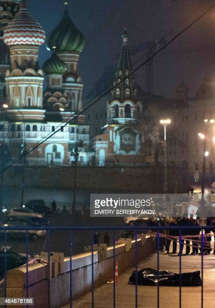 The body of Russian opposition leader Boris Nemtsov covered by plastic lies on Bolshoi Moskvoretsky bridge near St Basil cathedral in central Moscow...