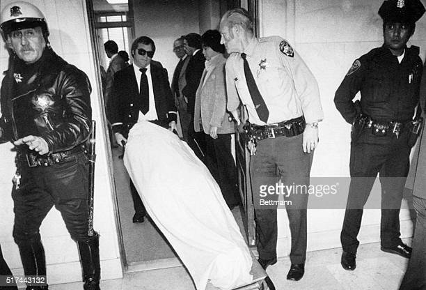 The body of Supervisor Harvey Milk is wheeled from his chambers at City Hall after he and Mayor George Moscone were shot and killed here 11/27 Former...
