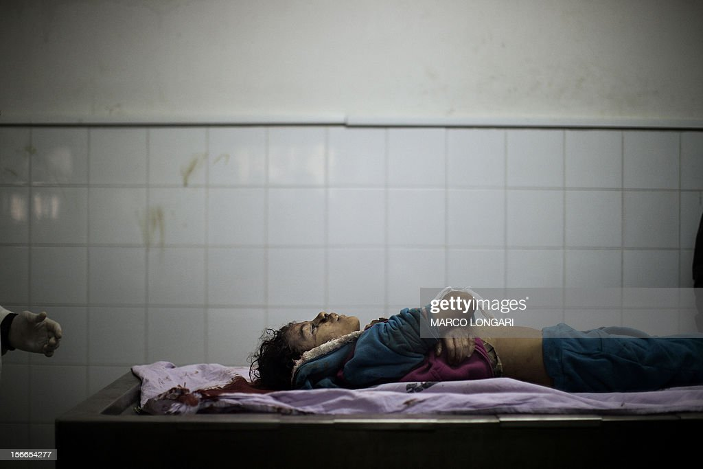 The body of Tasneem al-Nahal, 13, lies in the morgue of the al-Shifa hospital in Gaza City after she was killed by an Israeli airstrike in Shati refugee camp November 18, 2012. An Arab League delegation headed by the bloc's chief Nabil al-Arabi will visit Gaza on November 20, in a show of support for the territory in the face of Israeli air strikes, a league official said.