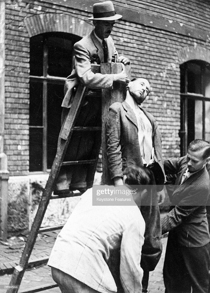 The body of the fascist leader Nickhazi Janos being cut down after he was hanged.