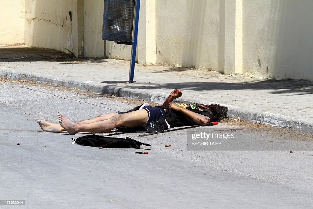 The body of the gunman is seen on the ground in the town of Sousse a popular tourist destination 140 kilometres south of the Tunisian capital on June...