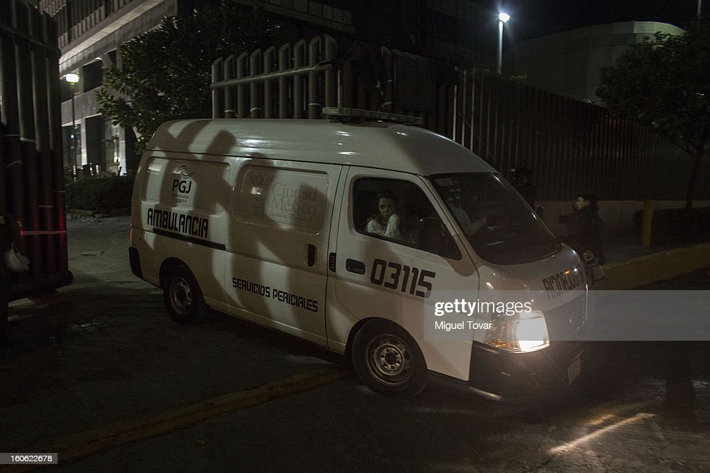 The body of the victim 34 is transported by Forensic workers outside the administrative building of PEMEX on February 03, 2013 in Mexico City, Mexico. Authorities investigate a blast that killed at least 34 people at the state-owned companyÕs headquarters in Mexico City.