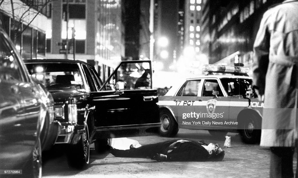 The body of Thomas Bilotti friend and chauffeur of Mafia boss Paul Castellano lies in the street after he and Castellano were shot and killed outside...
