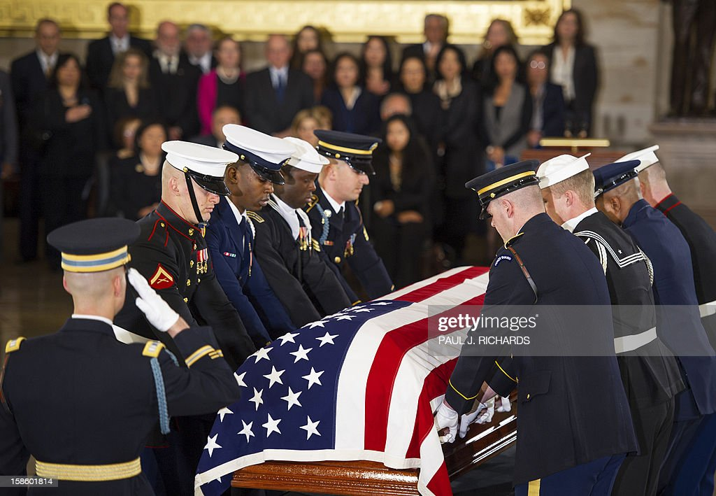 The body of US Senator Daniel K. Inouye,(D-HI) is carried in a flag draped casked by US Honor Guard to Lie in State the floor of the US Capitol Rotunda on December 20, 2012, in Washington, DC. Inouye, one of the last World War II heroes in Congress and the longest-serving member of the US Senate, having represented Hawaii since the state joined the union in 1959, died at age 88. AFP PHOTO/Paul J. Richards