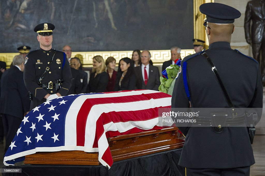 The body of US Senator Daniel K. Inouye,(D-HI) is guarded by US Capitol Police Lying in State with a flag draped casked on the floor of the US Capitol Rotunda December 20, 2012, in Washington, DC. Inouye, one of the last World War II heroes in Congress and the longest-serving member of the US Senate, having represented Hawaii since the state joined the union in 1959, died at age 88. AFP PHOTO/Paul J. Richards
