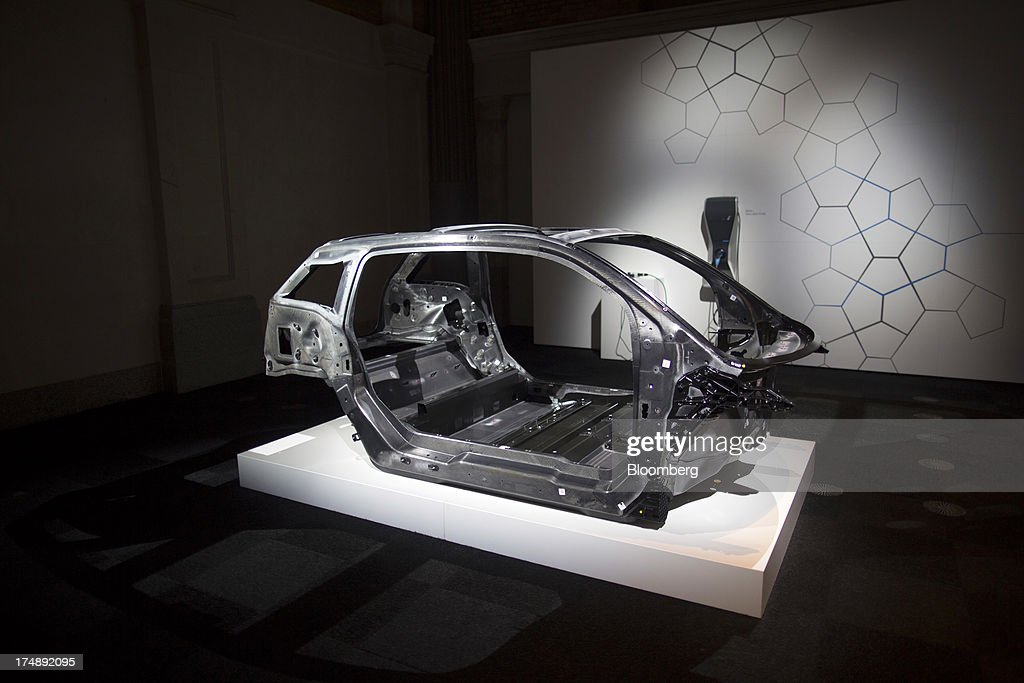 The body shell of the BMW i3, the electric automobile produced by Bayerische Motoren Werke AG (BMW), sits on display during the unveiling of the vehicle at the world premiere launch in London, U.K., on Monday, July 29, 2013. To avoid the fate of other slow-selling electric vehicles, Bayerische Motoren Werke AG will offer the new i3 -- a battery-powered compact car -- with a unique option: the use of a sport-utility vehicle. Photographer: Simon Dawson/Bloomberg via Getty Images