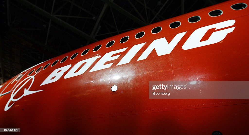 The Boeing Co. logo appears on the side of the 747-8 Intercontinental as the jumbo jet is rolled out at the company's manufacturing facility in Everett, Washington, U.S., on Sunday, Feb. 13, 2011. Boeing aims for the passenger version of the delayed 747-8 shown to customers and investors today to fly for the first time in March, a little more than a year after the freighter variant. Photographer: Kevin P. Casey/Bloomberg via Getty Images