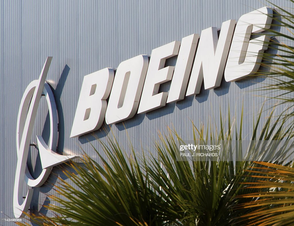 The Boeing logo is seen at Boeing's new production facilities April 27, 2012, in North Charlston, South Carolina. Boeing rolled-off it's first South Carolina made 787 Dreamliner aircraft here today. AFP PHOTO/Paul J. Richards