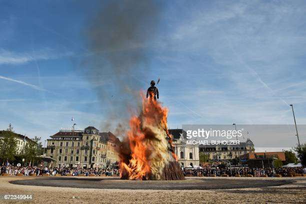 The Boeoegg a giant symbolic snowman made of wadding and and filled with firecrackers burns on top of a bonfire in Sechselaeuten square on April 24...