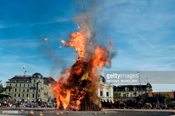 CORRECTION The Boeoegg a giant symbolic snowman made of wadding and and filled with firecrackers burns on top of a bonfire in Sechselaeuten square on...