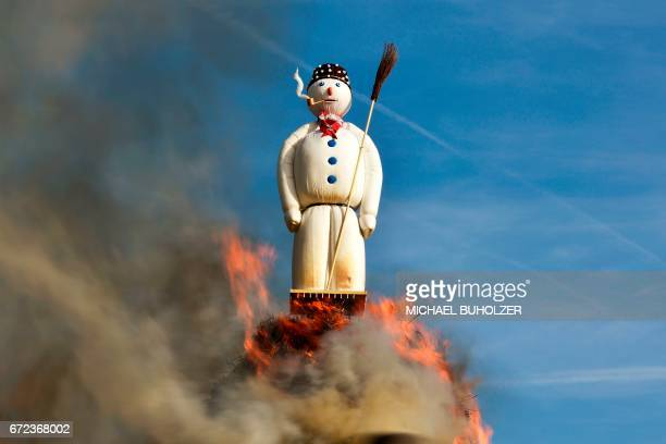The Boeoegg a giant symbolic snowman made of wadding and filled with firecrackers burns ontop a bonfire in Sechselaeuten square on April 24 2017 in...