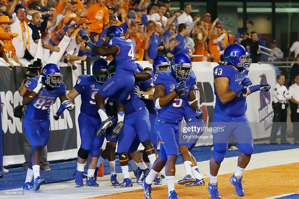 The Boise State Broncos celebrate after a pick six against the BYU Cougars at Bronco Stadium on September 20, 2012 in Boise, Idaho.