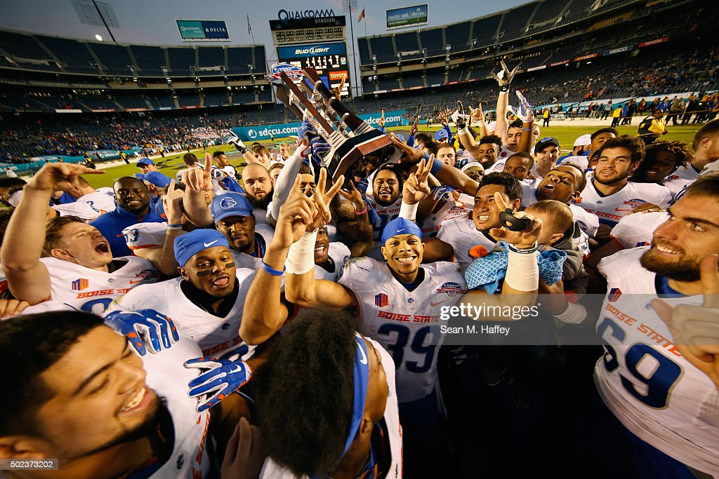 The Boise State Broncos celebrate the win over the Northern Illinois Huskies in the San Diego County Credit Union Poinsettia Bowl on December 23 2015...