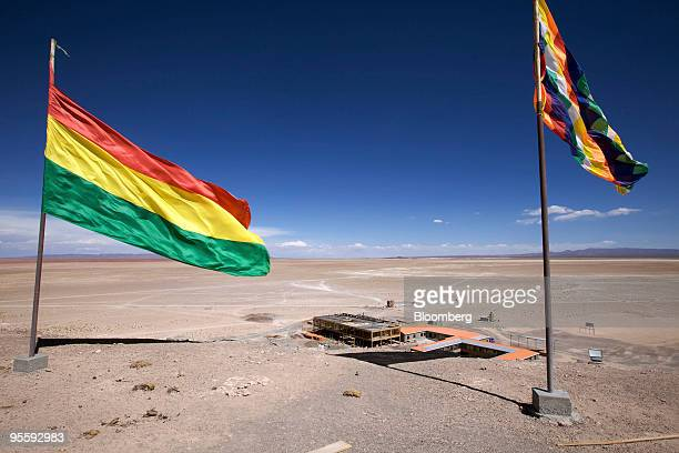 The Bolivian flag left and the Wiphala flag for indigenous rights fly above the Bolivian government's pilot plant for lithium production at the Uyuni...